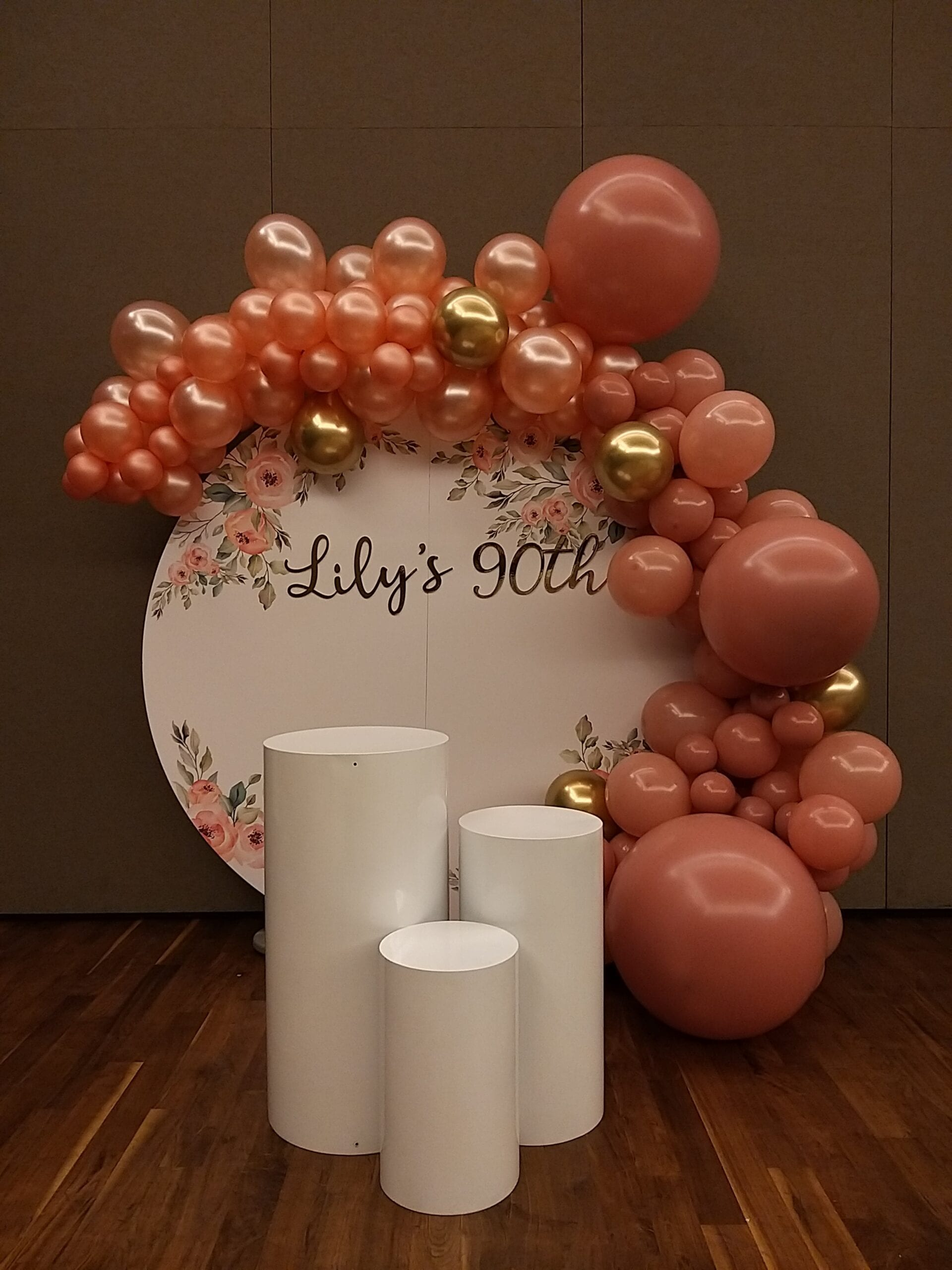 Organic balloon backdrop with customised circle backdrop.