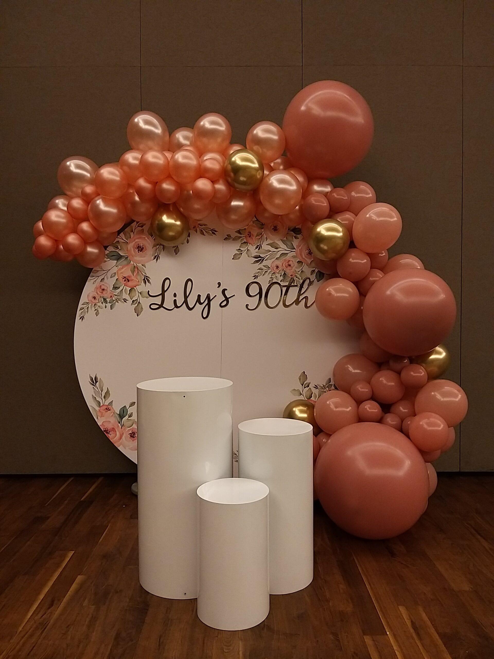 Organic balloon backdrop with customised circle backdrop.