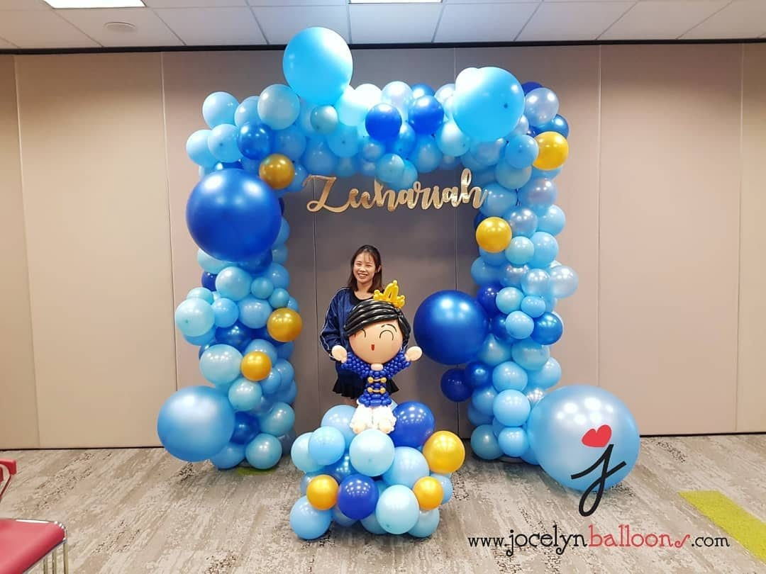 Organic balloon backdrop with laser cut name and balloon prince