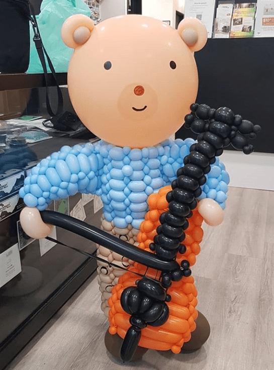 Balloon Bear holding a violin sculpture