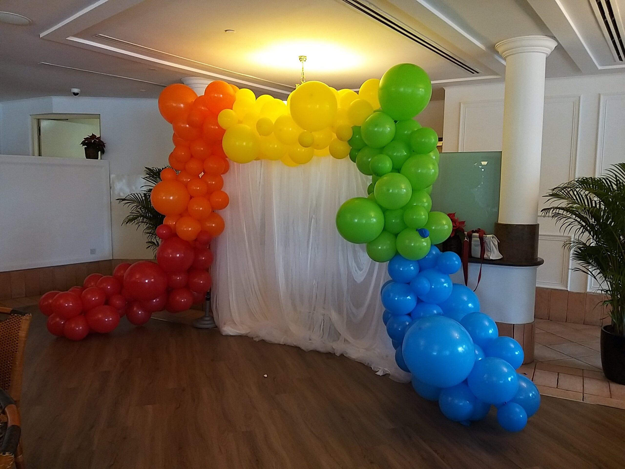 Rainbow organic balloon garland backdrop
